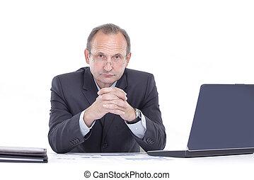 close up. Executive businessman sitting at his Desk