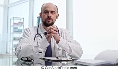 close-up. experienced doctor attentively listens to the complaints of his patient .