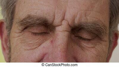 Close-up. Eyes of an elderly man. 6k
