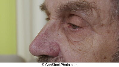 Close-up. Eyes of an elderly man. Side view. 6k