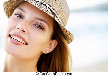 A woman smiling with brown eyes