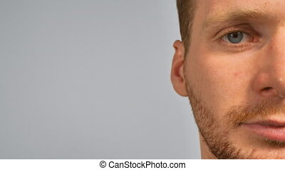close up face grave man with beard - part of face serious ...