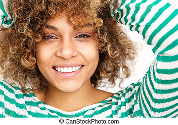 Close up face happy young african american woman smiling