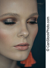 Close-up face of a beautiful girl model with professional makeup