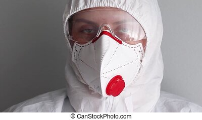 Close up face of woman in medical protective uniform, goggles and a face mask for corona virus prevention. Coronavirus COVID-19