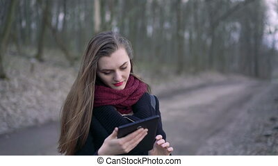 Close-up face of a young girl enjoying tablet. 4k