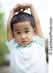 close up face of asian children boy looking to camera with eye contact