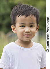 close up face of asian children looking to camera