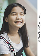 close up face of asian teenager laughing with happiness...