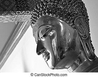 Close up face of Buddha statue