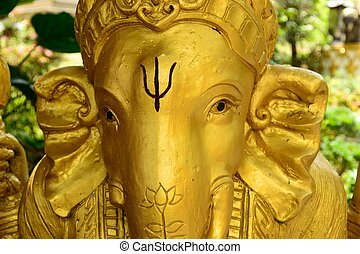 Close up face of Golden Ganesh Statue