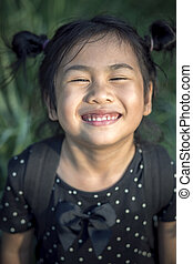 close up face of lovely asian children funny emotion