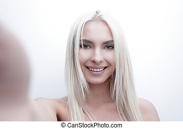 close-up face of serious beautiful blond woman. Photo with blank space