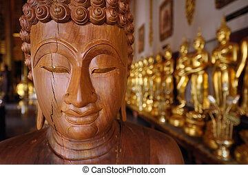 Close up face of wooden statue buddha