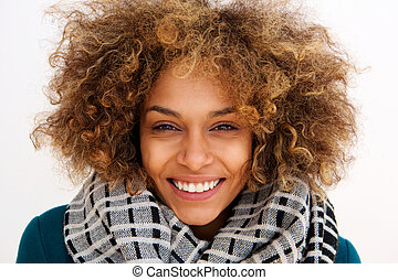 face portrait of smiling african american woman with scarf