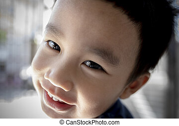 close up face with eye contact of asian children