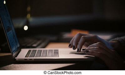 Close-up female fingers on laptop touchpad. Girl surfing the...