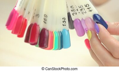 Close up female hand and nail color palette. Gentle woman...