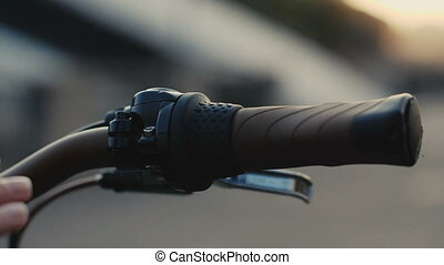 Close up Female hand touching handlebar bike slow motion -...