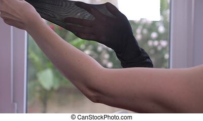 close-up. Female hands test the integrity of kapron...