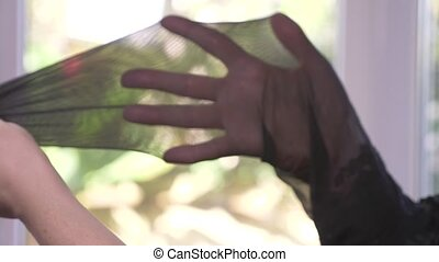 close-up. Female hands test the integrity of stockings. a...