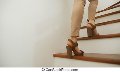 close-up, female legs in beige tight fitting pants and...
