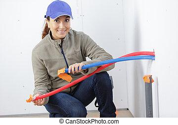 close up female plumber during repairs