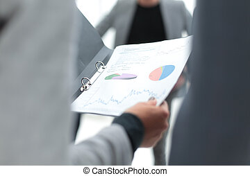close up. financial document in the hands of a business woman