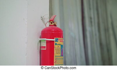 Close-up fire extinguisher at the factory on the white...