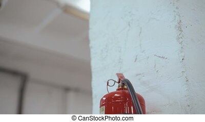 Close-up fire extinguisher at the factory on the white background 4K