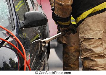Close up fireman with pry bar.