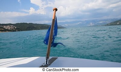 Close up flag of EU waving in wind on boat stern