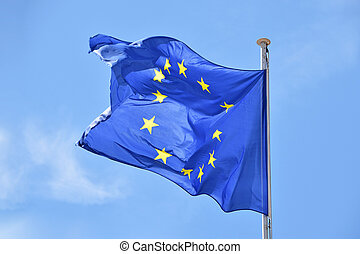 Close up flag of EU waving in wind over blue sky