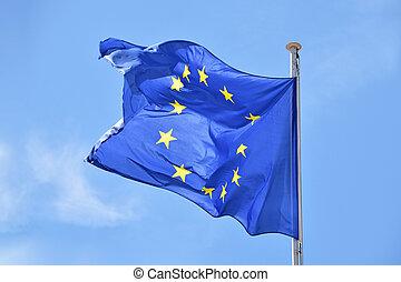 Close up flag of EU waving in wind over blue sky