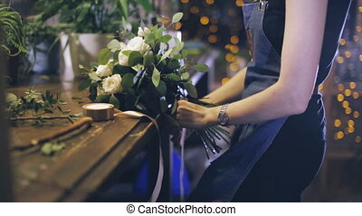 Close-up. florist making bouquet at flower shop