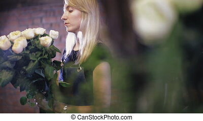 Close-up. Florist preparing a flower bouquet in floral shop