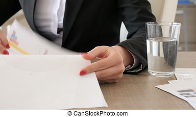 Close up footage of businesswoman hands looking and...
