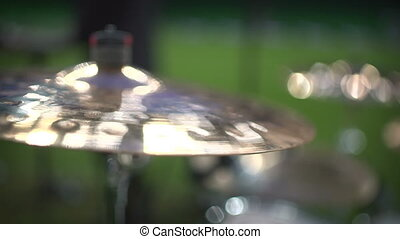 Close up footage of two drum sticks hitting a drum plates