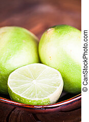 Close up fresh citrus lime wholes and slice
