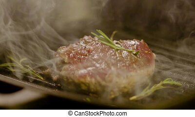 Steak Fried On A Grill With Rosemary