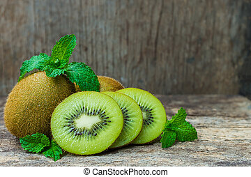 Close up fresh kiwi fruit on old wood background. Kiwi fruit...