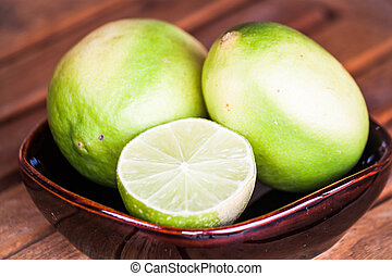 Close up fresh lime wholes and slice
