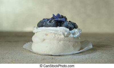 Close-up fresh tasty airy cake with blueberries on a napkin...