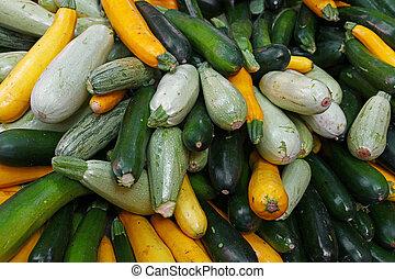 Close up fresh zucchini on retail display