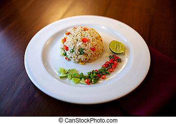 Close up Fried rice with vegetables Asian food on table