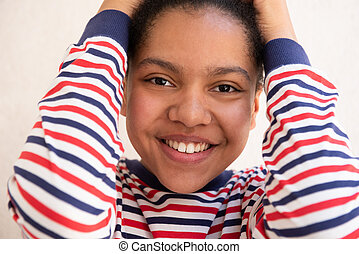 Close up front of smiling young african american girl