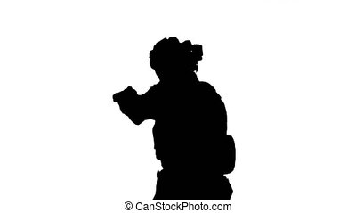 Close up. Front view. Army man pointing gun in multiple directions ready for combat, Alpha Channel Professional shot in 4K resolution. 048. You can use it e.g. in your medical, commercial video, business, presentation, broadcast