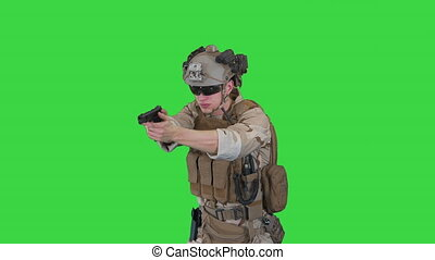 Close up. Front view. Army man pointing gun in multiple directions ready for combat on a Green Screen, Chroma Key. Professional shot in 4K resolution. 048. You can use it e.g. in your medical, commercial video, business, presentation, broadcast