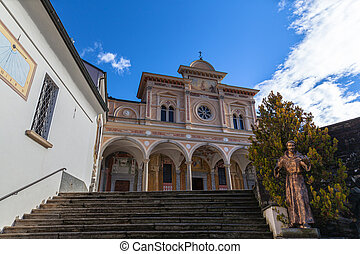 Close up front view of Madonna del Sasso church above Locarno city oa sanctuary and pilgrimage church in Orselina, in autumn on sunny day with blue sky cloud, Canton of Ticino, Switzerland