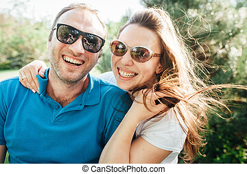 Close up funny beauty portrait of happy hipster couple